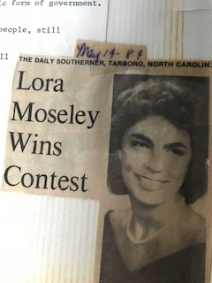 Lora Moseley news paper clipping
